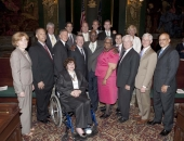 Senator Brewster and members of the senate pose with Benard Hopkins, Jr.
